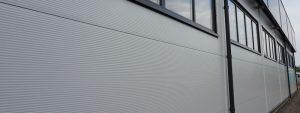Ściany z płyt warstwowych w budownictwie przemysłowym - Stick Hale